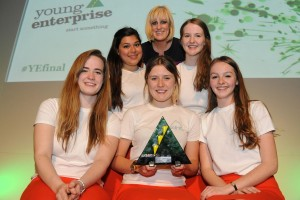 Prime from Tiffin Girls' School, Kingston, London were named Young Enterprise Company of the Year 2013. They are seen here with the finals host Steph McGovern, the main business presenter of BBC Breakfast. Prime sold a special amplifier called megaphone made of silicon that works without electricity.